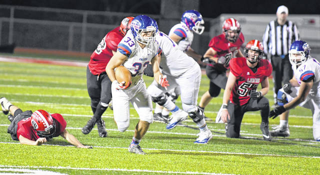 Clinton-Massie's Robbie Frederick breaks through the line in last week's game against New Richmond.