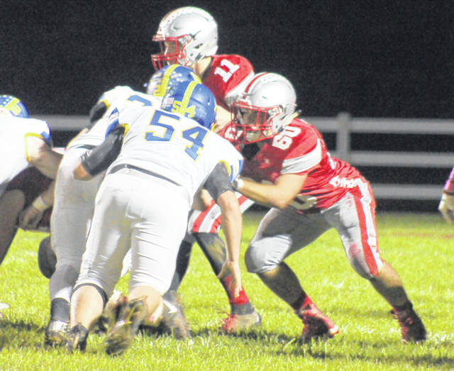 Garrett Elzey (60) with the block for East Clinton Friday night against Clermont Northeastern.