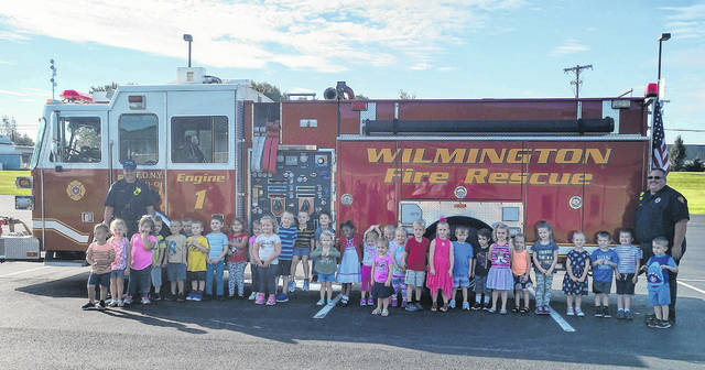 In observance of Fire Prevention Month, the Wilmington Fire Department visited the preschool classes at Bright Beginnings Tuesday School at Bible Baptist Church Wilmington. Pictured with the preschoolers are Lt. Ed Myers and firefighter Martin Cline.