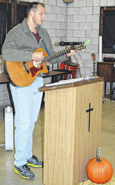 "James Godfrey of Chester Friends Meeting in Clinton County, pictured, was one of a number of vocalists at the ""Sing for Missions: A Roof for Wilmington School"" held Oct. 13 at the Quaker Knoll Campground near Cowan Lake State Park. The event, including Cuban food and a meal, was a fundraiser to help rebuild the Wilmington School on the island of Cuba."