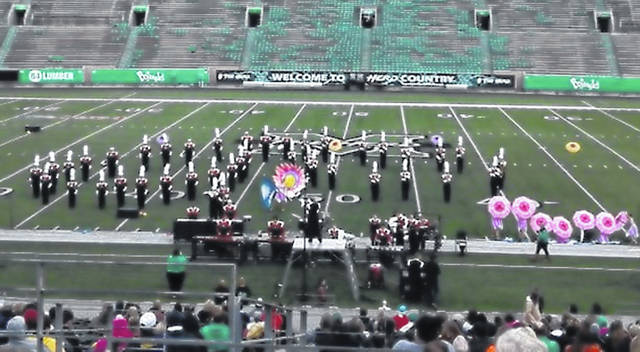 The East Clinton Marching Band on the field at Marshall University.