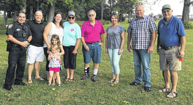 From left are Wilmington Police Officer Michael Estle; residents Jarett Roush, Holly Roush, Karen Johnson, Dick Williams and Marnie Reed; Wilmington Police Chief Duane Weyand; and Mayor John Stanforth at the McDermott Village Neighborhood Watch Party on Saturday.