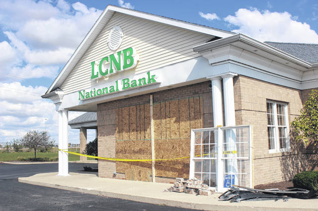 A driver who lost control of a vehicle he was driving crashed into LCNB National Bank in Washington C.H. Monday night. The bank was under repair on Tuesday.
