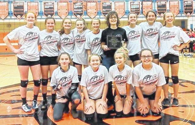 The East Clinton eighth grade volleyball teams, undefeated champions of the SBAAC, are, from left to right, front row, Morgan Michael, Lauren Stonewall, Aubrie Simpson, Cadence Howard; back row, Jozie Jones, Eryn Bowman, Savannah Tolle, Trinity Bain, Megan Tong, coach Jaime Evanshine, Kami Whiteaker, Libby Evanshine, Hayleigh Perdue. Assistant coach Cassie Findley was not present for the photo.