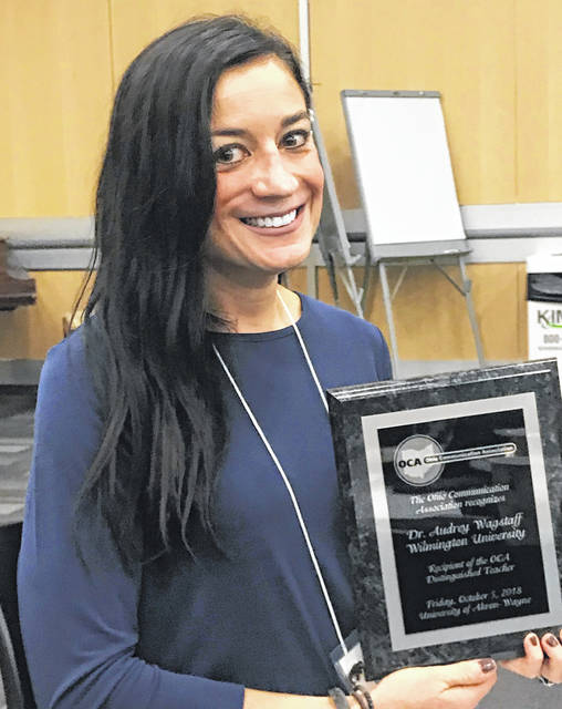 "Audrey Wagstaff earned a ""Distinguished Teacher of the Year"" award."