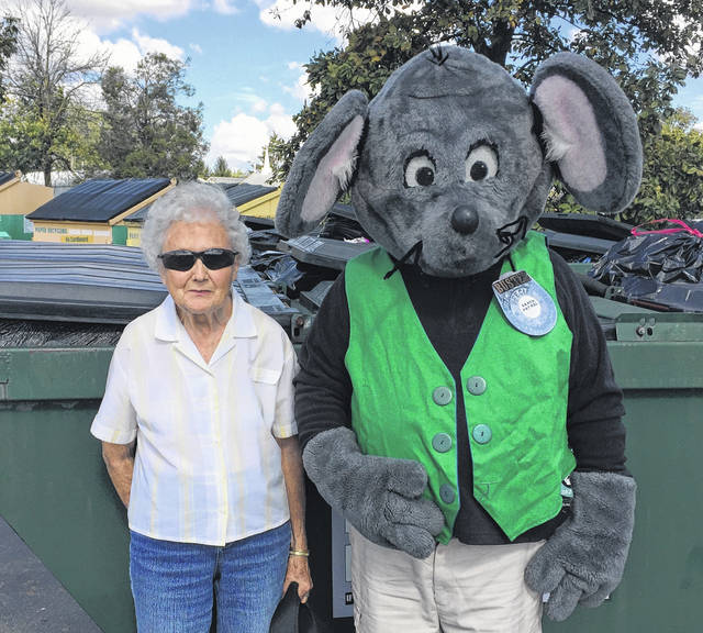 "Buster the Mouse, from the Clinton County Solid Waste District, has caught the second winner in the Get Caught Recycling Campaign. Virginia Saville was caught ""green-handed"" putting the proper recyclables into the community drop-off recycling containers at IGA in Sabina. For her efforts in practicing the 3-R's, Mrs. Saville received several recycled-content prizes, including a hammock and a backpack made from plastic bottles. Don't miss out on this chance to win great prizes by simply recycling household items such as bottles, jars, and newspapers. For a list of the local recycling drop-off locations and acceptable materials, visit the SWMD's website at www.co.clinton.oh.us/recycling. And be on the lookout … you could be the next person caught green-handed!"