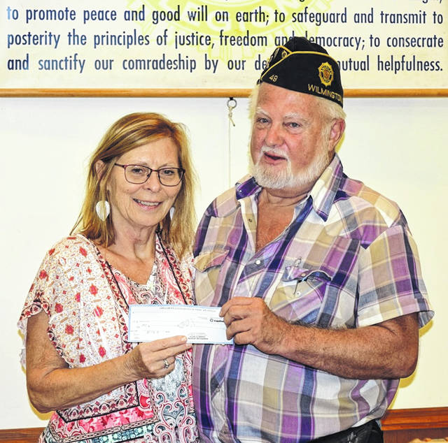 Patti Settlemyre, Executive Director of Community Care Hospice, recently spoke to members of American Legion Post 49 prior to being presented with a check for $2,000 by Post Commander Jim Cook.