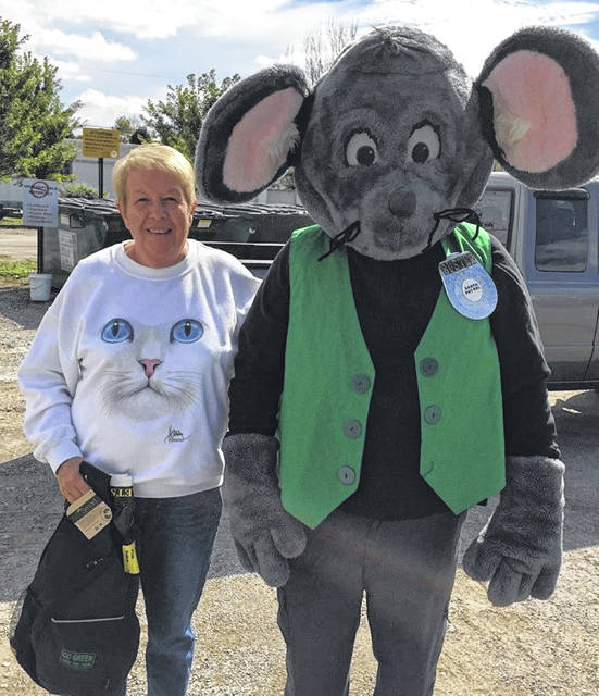 Buster the Mouse from the Clinton County Solid Waste District recently caught Dorothy Binkley putting proper recyclables into the community drop-off recycling containers in Blanchester. For her efforts in practicing the 3-Rs, Dorothy received several recycled content prizes. Don't miss out on this chance to win great prizes by simply recycling household items such as bottles, jars, and newspapers. For a list of the local recycling drop-off locations and acceptable materials, visit the SWMD's website www.co.clinton.oh.us/recycling. Be on the lookout … you could be the next person caught green-handed!