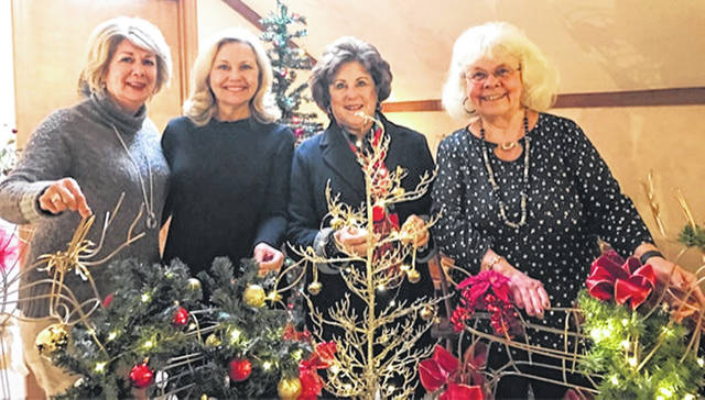 Members of the Health Alliance gather to work on decorations for the Holiday Ball which will take place Dec. 1. From left are Patti Cook, Chairman of the Auction Committee; Kathy Havey, President of the HACC; and Ann Johnson and Jennifer Hollon, Ball Chairmen.