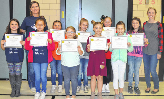 "These are participants in the Denver Place Elementary's ""Girls on the Run"" after-school program. From left in the front row are Claire Connor, Madison Owens, Bailey Nicely, Kassie Wisecup and Kendall Beus; and from left in the back row are coach Brandy Smith, Laila Salisbury, Kyla Adams, Izzy Rhoads, Zoey Fawcett and coach Sarah Goforth. Participating students not pictured are Hailey Brock, Caydee Copas and Sophie Harris. Coaches not pictured are Erin Sutton and Natalie Steinmetz."