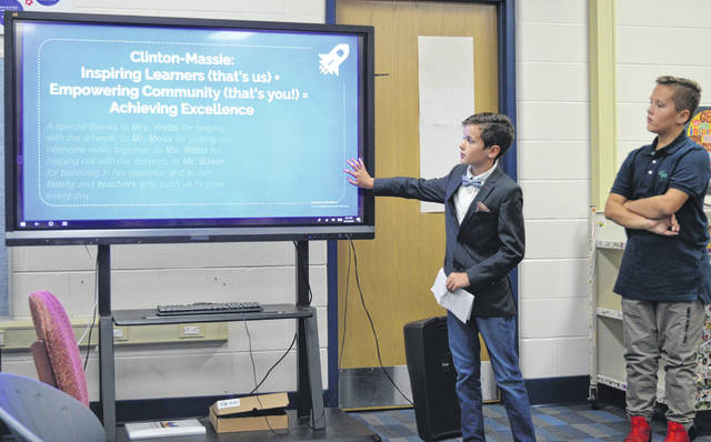 "Calm and assured fifth-grade student Danny Mefford speaks while changing what's on the touch-screen during the presentation ""Be the Inspiration: Clinton-Massie Students want to Soar"". Next to him is fifth-grade classmate Jace Pittser."
