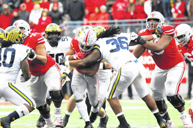 Ohio State's J.K. Dobbins encounters traffic in the Buckeyes' win over Michigan.