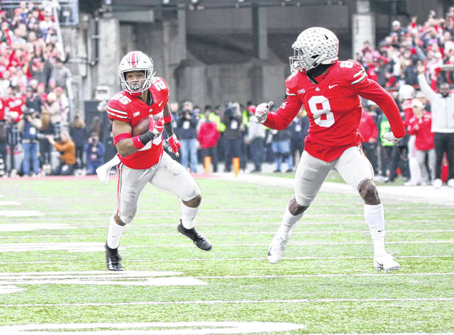 Ohio State's Brendon White returns an interception last week during the win over Michigan.