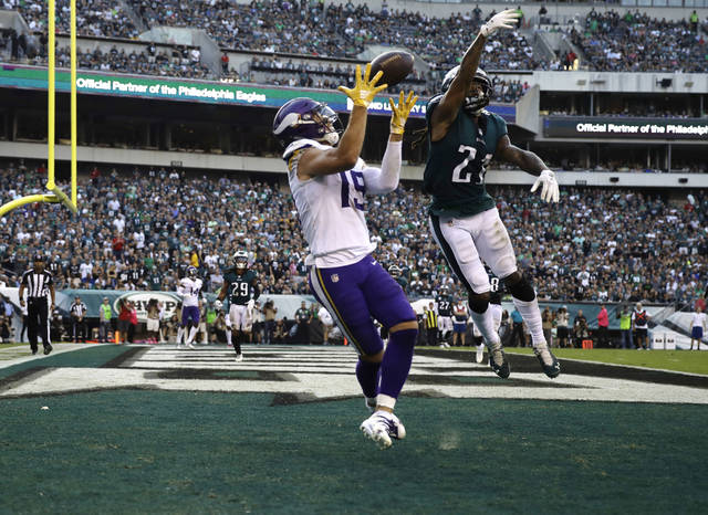 FILE - In this Oct. 7, 2018, file photo, Minnesota Vikings' Adam Thielen (19) catches a touchdown pass as Philadelphia Eagles' Ronald Darby (21) defends during the first half of an NFL football game in Philadelphia. Thielen is doing things even Hall of Famers Cris Carter and Randy Moss didn't accomplish in Minnesota. The undrafted wide receiver from NCAA Division II Minnesota State is the first player in NFL history with at least 100 yards receiving in eight straight games to start the season. Calvin Johnson also had an eight-game streak in 2012. (AP Photo/Matt Rourke, File)