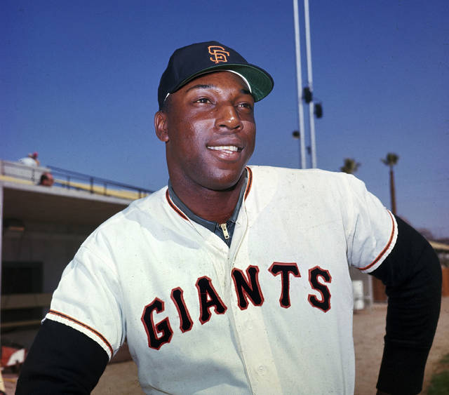"FILE - In this April 1964 file photo, San Francisco Giants' Willie McCovey poses for a photo, date and location not known. McCovey, the sweet-swinging Hall of Famer nicknamed ""Stretch"" for his 6-foot-4 height and those long arms, has died. He was 80.  The San Francisco Giants announced his death, saying the fearsome hitter passed ""peacefully"" Wednesday afternoon, Oct. 31, 2018, ""after losing his battle with ongoing health issues.""  (AP Photo, File)"