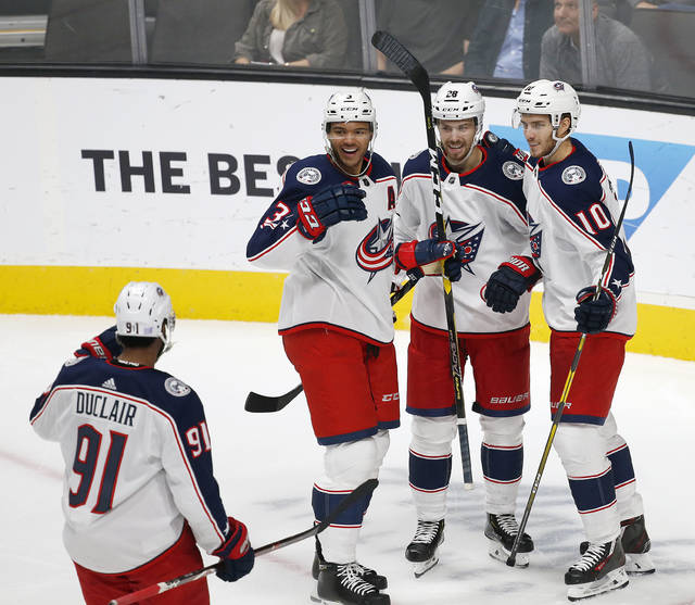 Columbus Blue Jackets' Anthony Duclair (91), Seth Jones (3), Oliver Bjorkstrand (28), and Alexander Wennberg (10) celebrate a goal against the San Jose Sharks during the second period of an NHL hockey game in San Jose, Calif., Thursday, Nov. 1, 2018. (AP Photo/Josie Lepe)