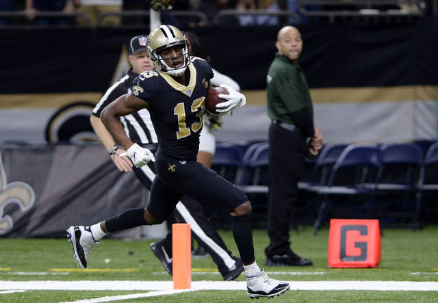 New Orleans Saints wide receiver Michael Thomas (13) scores on a 72 yard touchdown reception in the second half of an NFL football game against the Los Angeles Rams in New Orleans, Sunday, Nov. 4, 2018. (AP Photo/Bill Feig)