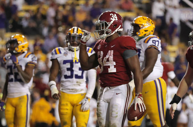 Alabama running back Damien Harris (34) waves goodbye to LSU fans after his touchdown in the second half of an NCAA college football game against LSU in Baton Rouge, La., Saturday, Nov. 3, 2018. Alabama won 29-0. (AP Photo/Gerald Herbert)