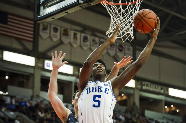 FILE - In this Aug. 17, 2018, file photo ,Duke' R.J. Barrett (5) shoots against a Toronto defender during a college basketball exhibition game in Mississauga, Ontario. Barrett was the lone freshman included in the Associated Press preseason All-America team. (Christopher Katsarov/The Canadian Press via AP, File)