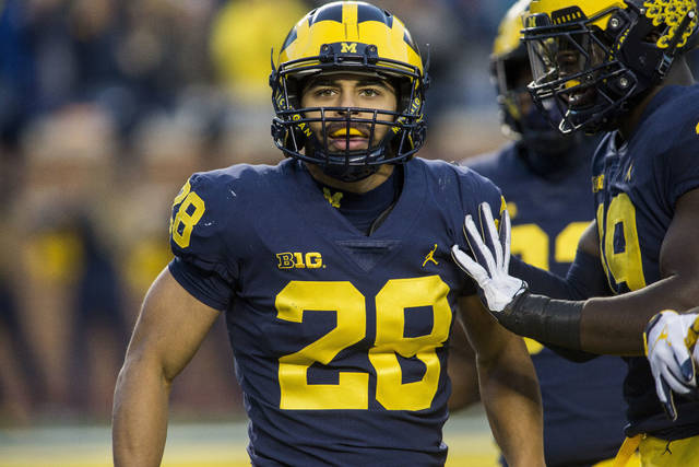 Michigan defensive back Brandon Watson (28) celebrates with defensive lineman Kwity Paye, right, after returning an interception for a touchdown in the third quarter of an NCAA college football game against Penn State in Ann Arbor, Mich., Saturday, Nov. 3, 2018. Michigan won 42-7. (AP Photo/Tony Ding)