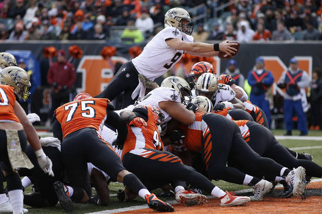 New Orleans Saints quarterback Drew Brees (9) dives in for a touchdown in the second half of an NFL football game, Sunday, Nov. 11, 2018, in Cincinnati. (AP Photo/Gary Landers)