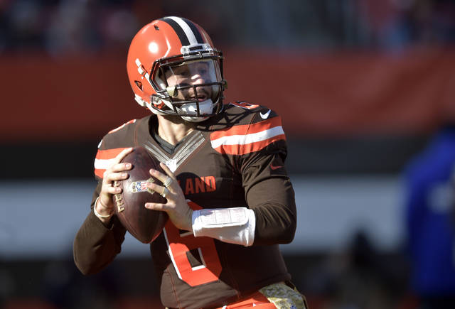 FILE - In this Sunday, Nov. 11, 2018, file photo, Cleveland Browns quarterback Baker Mayfield (6) looks to pass during a 28-16 win over the Atlanta Falcons in an NFL football game in Cleveland. Mayfield has teamed up with Barstool Sports to raise money for Special Olympics in Ohio. A clothing line featuring Mayfield's likeness is being sold with 100 percent of the proceeds going to the organization that helps people with intellectual disabilities. (AP Photo/David Richard, File)