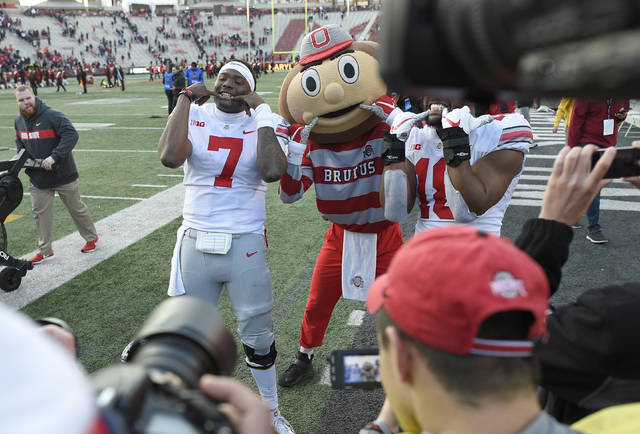 Ohio State quarterback Dwayne Haskins Jr. (7) poses for photographers with team mascot Brutus after an NCAA football game against Maryland, Saturday, Nov. 17, 2018, in College Park, Md. Ohio State won 52-51 in overtime. (AP Photo/Nick Wass)