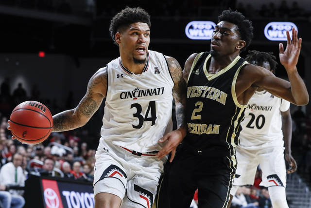 Cincinnati's Jarron Cumberland (34) drives against Western Michigan Adrian Martin (2) during the first half of an NCAA college basketball game, Monday, Nov. 19, 2018, in Cincinnati. (AP Photo/John Minchillo)