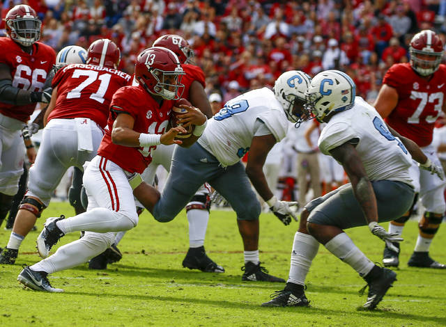 Alabama quarterback Tua Tagovailoa (13) carries the ball as he tries to get around Citadel linebacker Willie Eubanks III (9) during the second half of an NCAA college football game, Saturday, Nov. 17, 2018, in Tuscaloosa, Ala. (AP Photo/Butch Dill)
