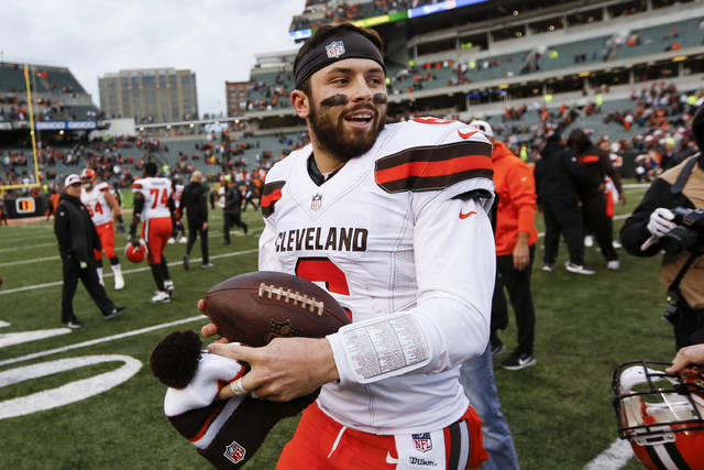 Cleveland Browns quarterback Baker Mayfield smiles after an NFL football game against the Cincinnati Bengals, Sunday, Nov. 25, 2018, in Cincinnati. (AP Photo/Frank Victores)