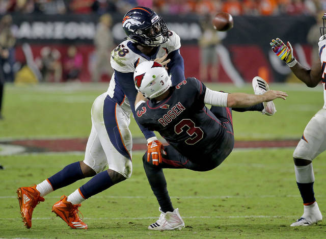 FILE - In this Oct. 18, 2018, file photo, Denver Broncos linebacker Von Miller (58) hits Arizona Cardinals quarterback Josh Rosen (3) as he throws during the second half of an NFL football game in Glendale, Ariz. Miller channeled Bill Belichick instead of heaping praise on his teammates following what might end up as a signature win. The Broncos have clawed their way back to relevance. But Miller responds to all questions about being 'onto Cincinnati' either as a singular focus or just to be funny. (AP Photo/Rick Scuteri, File)