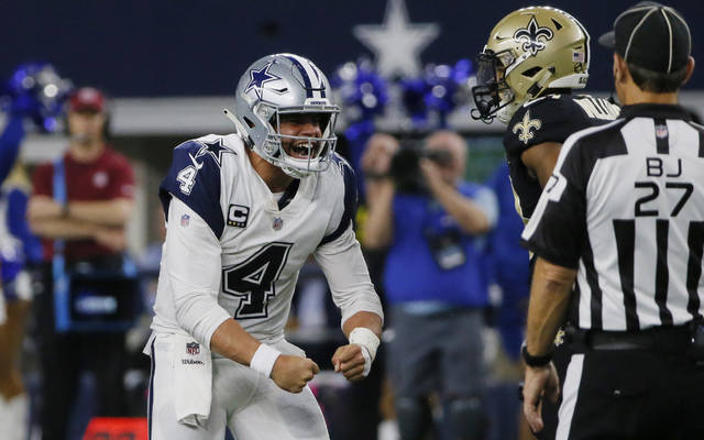 Dallas Cowboys quarterback Dak Prescott (4) celebrates after a run play against the New Orleans Saints during the second half of an NFL football game, in Arlington, Texas, Thursday, Nov. 29, 2018. Dallas won 13-10. (AP Photo/Roger Steinman)