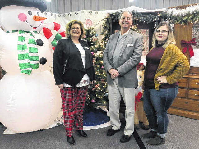 At the Wednesday, Nov. 28 holiday open house at the newly redesigned flea market are, from left, Caesar Creek Flea Market General Manager Mary Burr, Al Bell who is president and CEO of parent company Levin Service Co., and Caesar Creek Flea Market Operations Manager Taylor Clark.