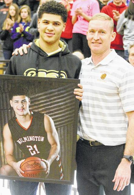 Jaevin Cumberland (left) is on the WHS Wall of Fame and scored a career high 31 points for Oakland University in Saturday's win. At the right is WHS head coach Michael Noszka.