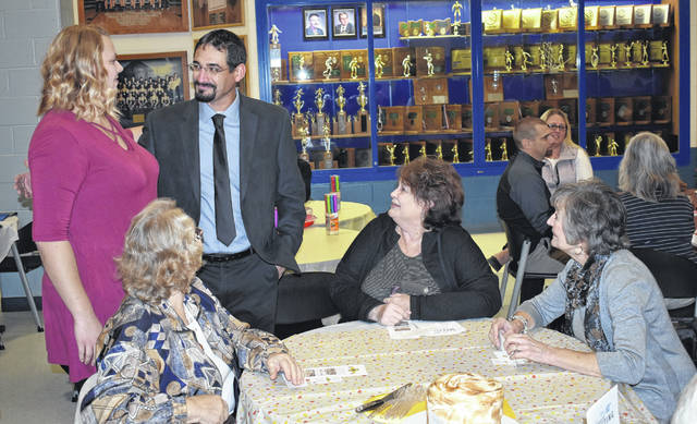 Citizen of the Year winner Tony Akers, second from left, chats with locals during the 63rd Annual Blanchester Chamber of Commerce Dinner on Tuesday.