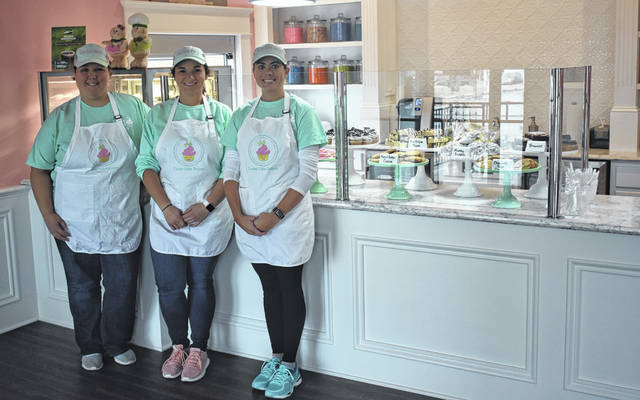 From left, Kristen Clifford, Delaney Roberts, and Leann Wagenseller offer sweet treats to locals at Laney Cakes Bakery on West Main Street.
