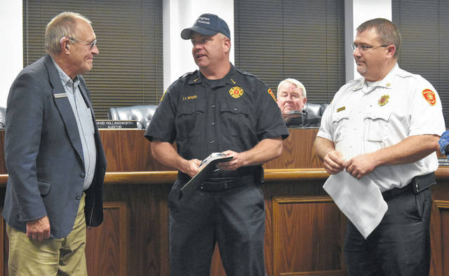 Wilmington Fire Department Lt. Ed Myers (center) was recognized at city council's meeting Thursday night for his 19 years of service with the department by Mayor John Stanforth, left, and WFD Chief Andy Mason. Myers recently accepted the position of Deputy Chief at the Goshen Township Fire Department.