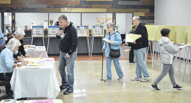 Mid-morning Election Day was comparatively slower than earlier at the Dove Church poll location off Rombach Avenue in Wilmington. Residents in three Wilmington precincts fill out their ballots at the church's large lobby: 1-A, 1-B, and 2-A.