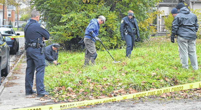 Members of the Ohio Detectors Association agreed to come out and use their expertise and equipment to help Wilmington police search for shell casings from an Oct. 30 shooting on Hawley Avenue in the city. In this photograph from Friday afternoon, Nov. 9, Wilmington Police Department (WPD) officers and the detectors organization members comb a grassy area along Hawley Avenue in hopes of finding casings. A suspect, Leon Turner Curtis, 37, of Wilmington, was arrested on Oct. 31. The victim was transported to Miami Valley Hospital, but is no longer a hospital patient, according to WPD.