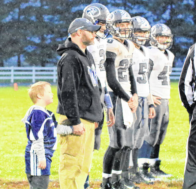Blanchester honorary captain MJ Miller (left) and his father along with Blanchester football players Brayden Sipple, Clayton Schirmer, Cody McCollister and James Peters