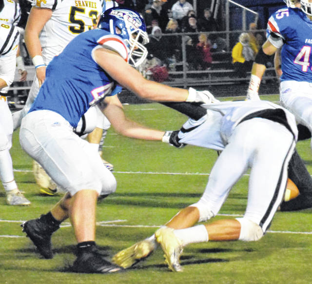 Come back here … Clinton-Massie's Clayton Sheeley (left) brings down a Shawnee ball carrier last week.