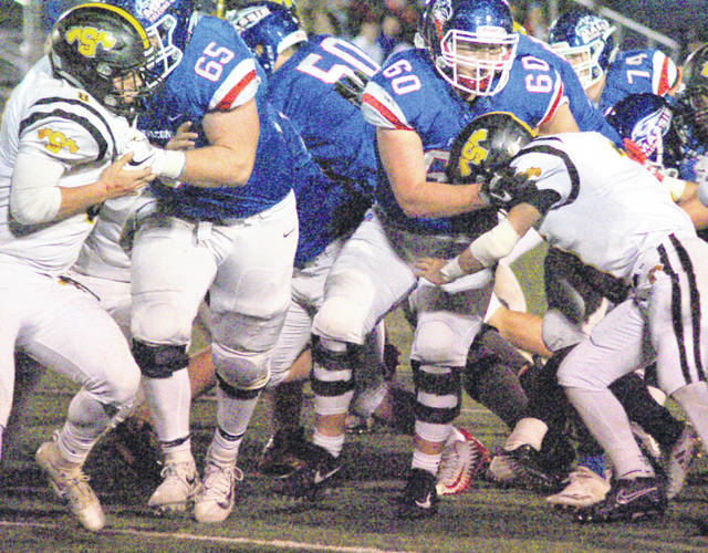 In the trenches, the Clinton-Massie offensive lineman (Matt Phillips 65, Seth Schmidt 50 and Seth Stiverson 60) overpower the Shawnee defense in last Saturday's game.