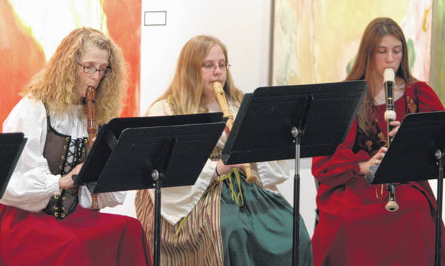 Elizabeth Haskins, left, plays the recorder in this 2009 performance by Collegium Musicum, which will have its final performance Nov. 29.