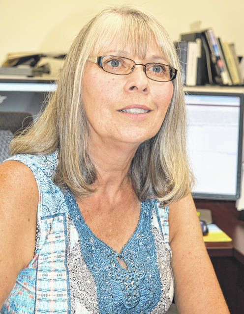 Clinton County Recorder Brenda Huff wants her former staffing level restored.