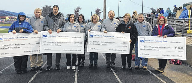 Merchants Bank made four $500 donations to Wilmington and Clinton-Massie schools.