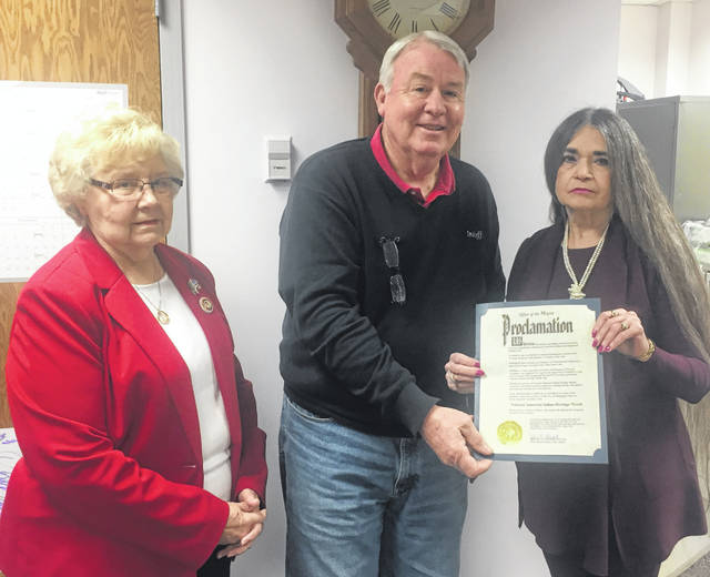 From left are Frances Sharp, DAR Regent; Mark McKay, Wilmington City Council President presenting the proclamation signed by Mayor John Stanforth; and DAR American Indians Chair Carol Darnell.