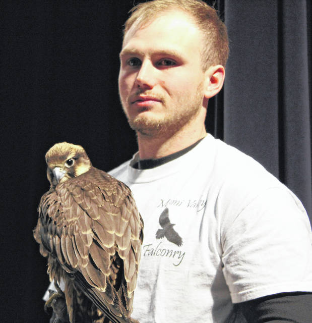 Army veteran and CMHS grad Adam McGuire visited, and is shown with one of his falcons.
