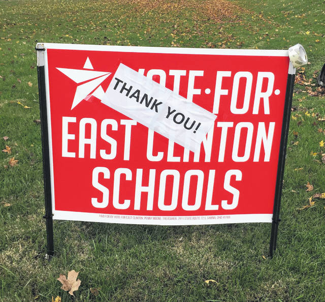 Campaign signs in the East Clinton school district were updated Wednesday morning as voters passed a bond issue Tuesday that will fund construction of a new middle school, and upgrade the high school and the elementaries in Sabina and New Vienna.