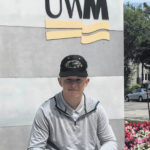 Morris signs with UWM
