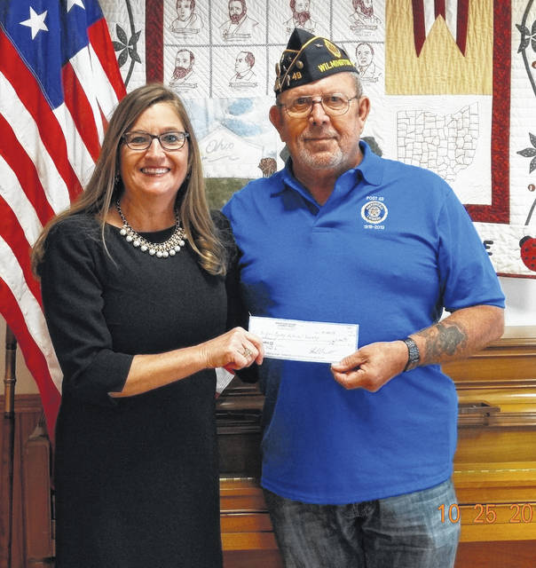 Cari Hansford Middleton receives a check for $1,000 from Jack Rose of Wilmington Veterans Post 49,
